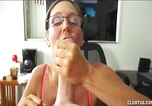 Mommy in glasses happily sucking a fat cock here