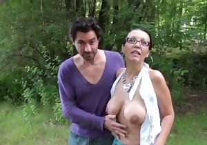 Big-breasted brunette getting dicked outdoors