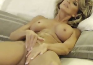 Messy-haired bitch with big boobs masturbates